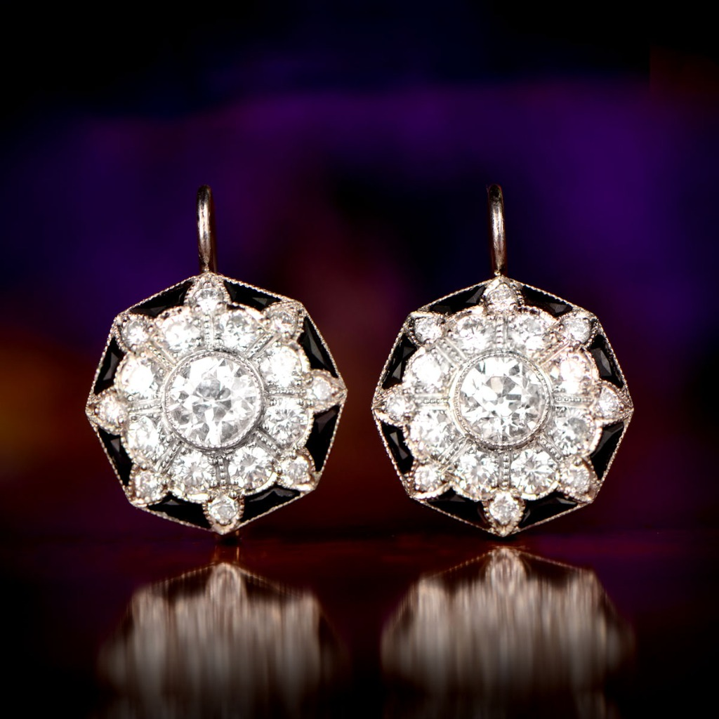 A beautiful and rare pair of earrings, featuring diamonds and onyx. Fine milgrain adorns the platinum!