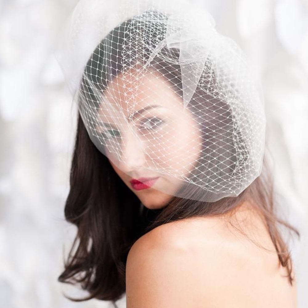 Our classic double layer birdcage veil features soft Russian veiling and illusion tulle. Available in multiple colors and lengths
