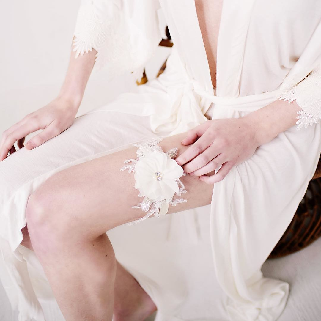 Our handmade chiffon garter features soft hand cut chiffon petals, silver inlay beads, lace, pearls, floral accents and soft elastic