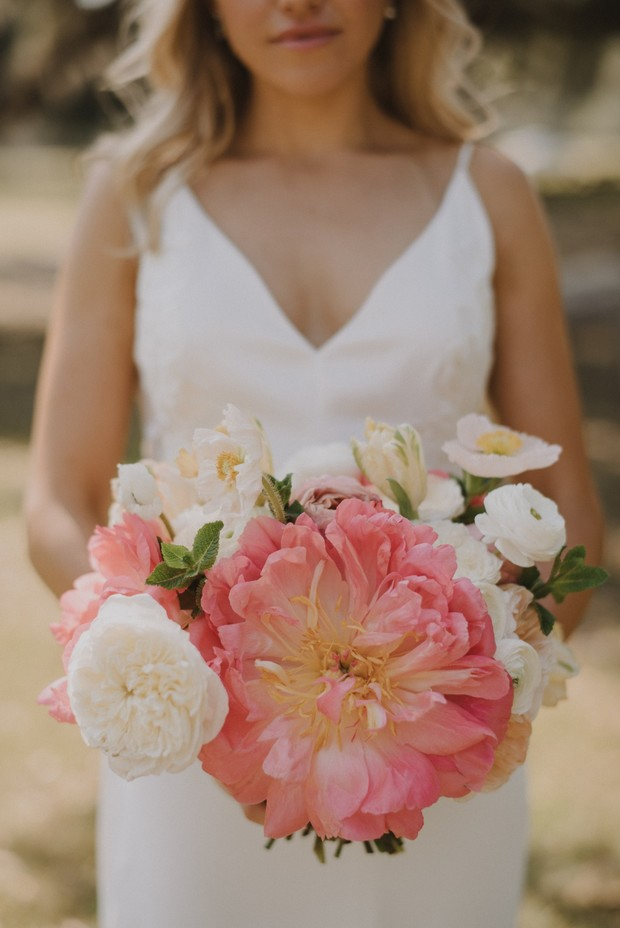 giant coral peony and white garden rose bridal bouquet