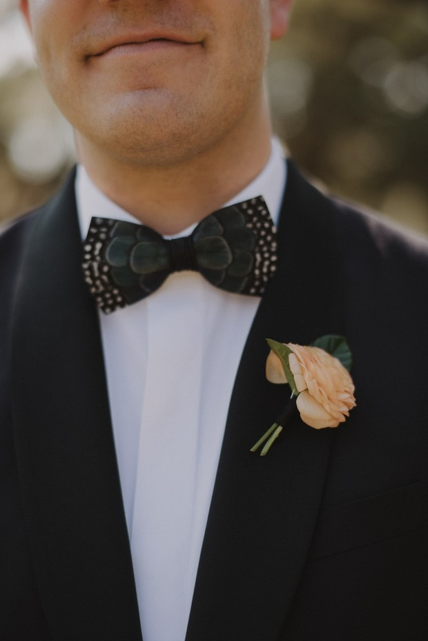 feather accented bow tie