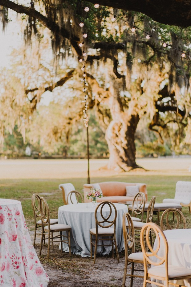 white and coral wedding reception outside