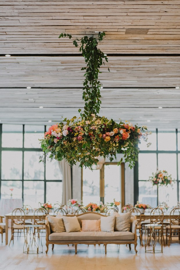 dramatic oversized floral chandelier over the dance floor