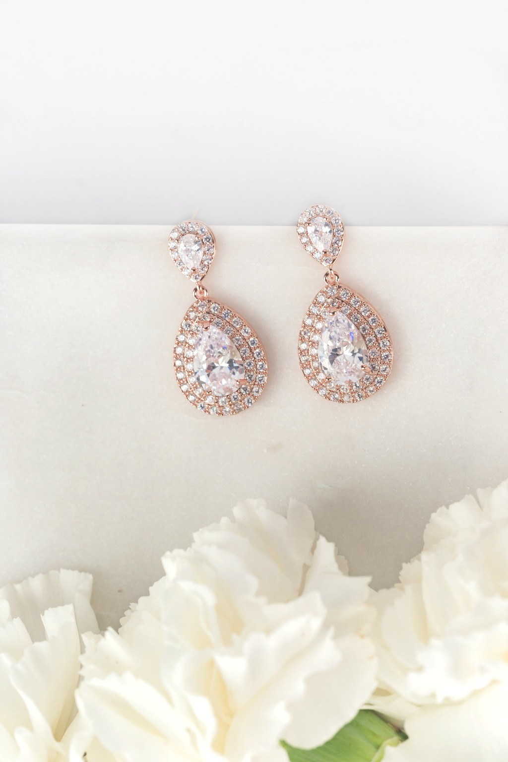 The shimmering Harlow earrings add a classy touch for both the bride and her bridesmaids. Find more beautiful wedding jewelry at Wink