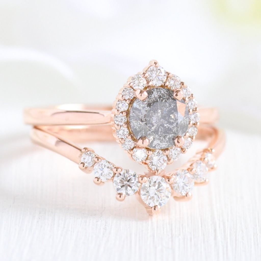 Elegant yet unique creation! This diamond bridal set features a grey diamond engagement ring with a round cut salt and pepper diamond