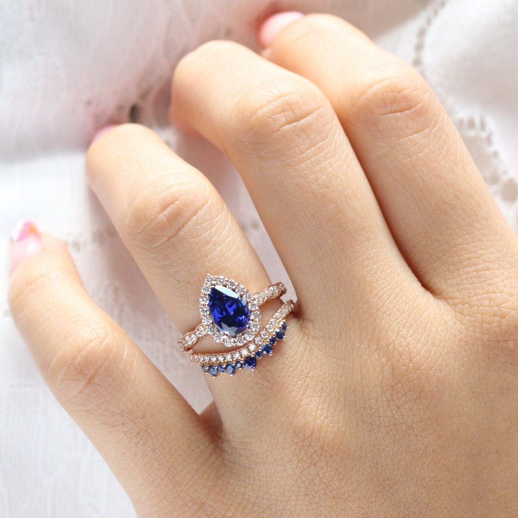 Breathtakingly gorgeous sapphire ring bridal set features a sapphire engagement ring set in 14k rose gold luna halo diamond ring setting