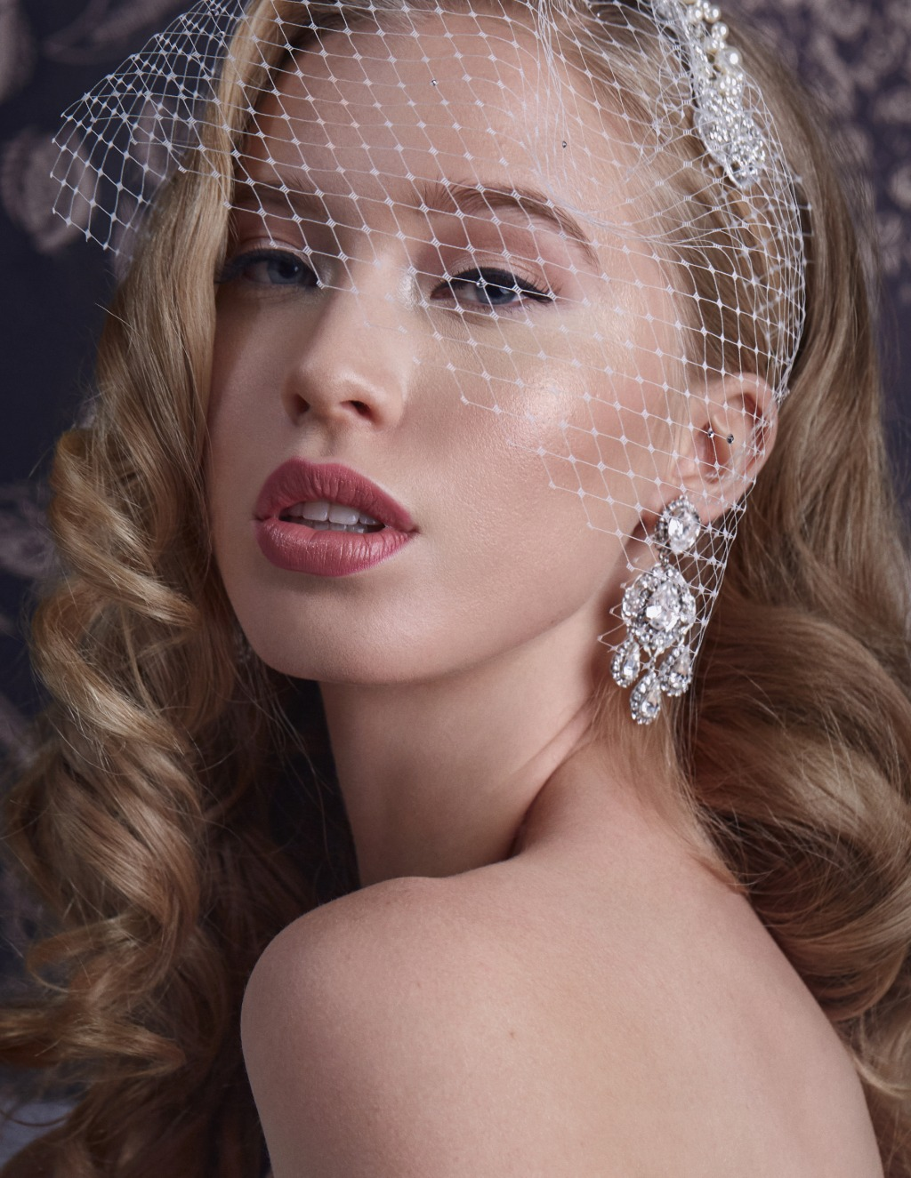 Check out the high-shine bridal Chandelier earring from Laura Jayne's website.