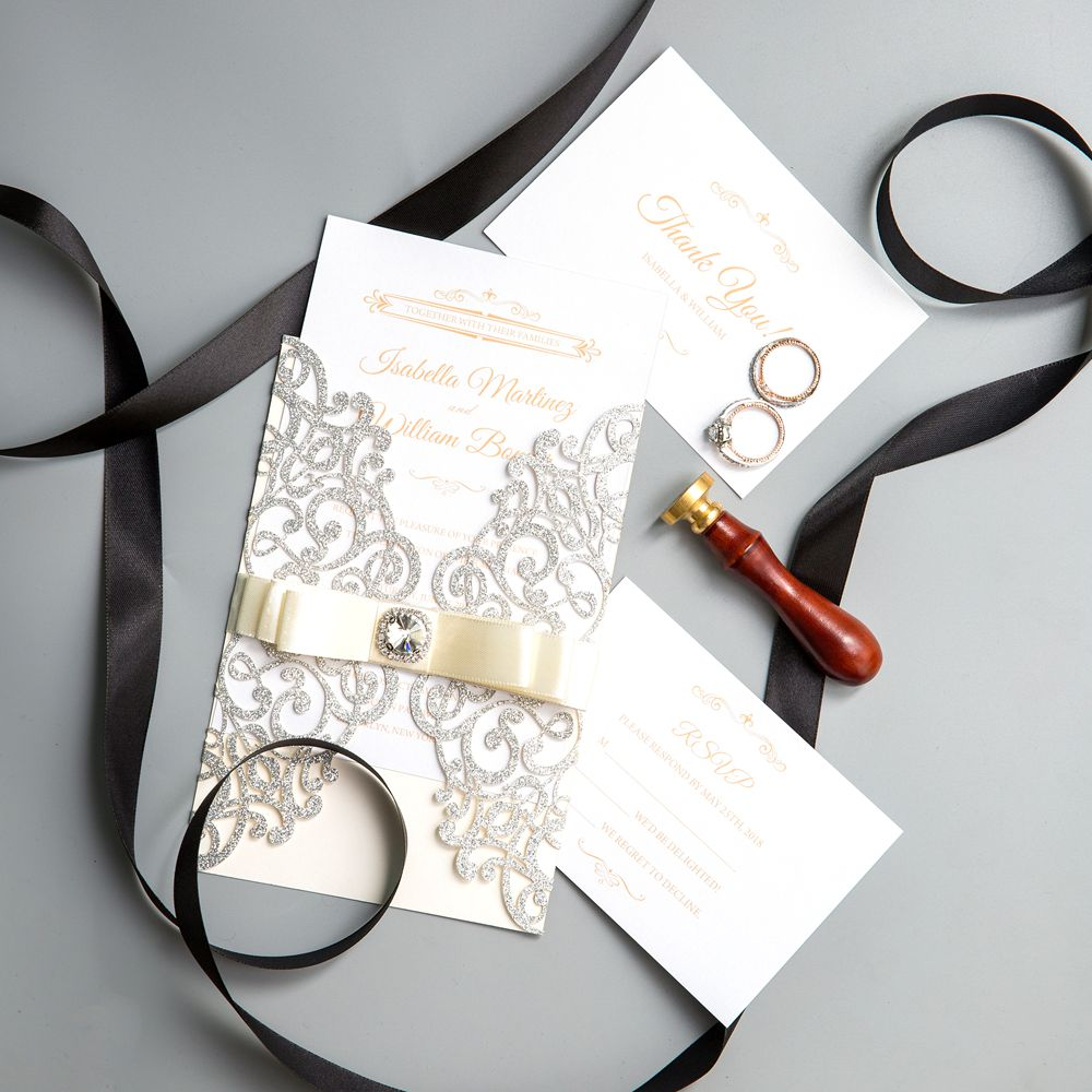A glittery silver laser cut fold wrapped by a glittery crystal belly band is sure to delight your guests at any time of year.