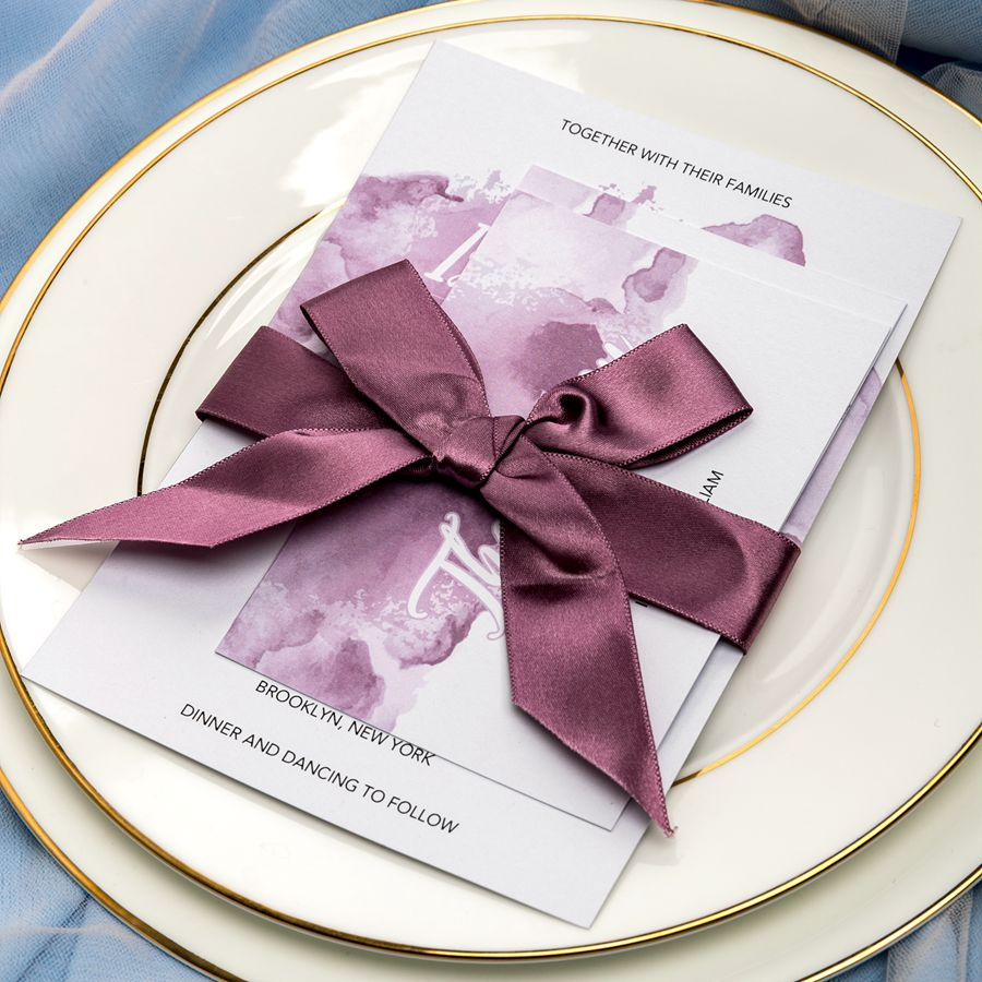 This chic wedding invitation takes with it a large area of watercolor from cardstock to rsvp and thank you cards. The uniform design