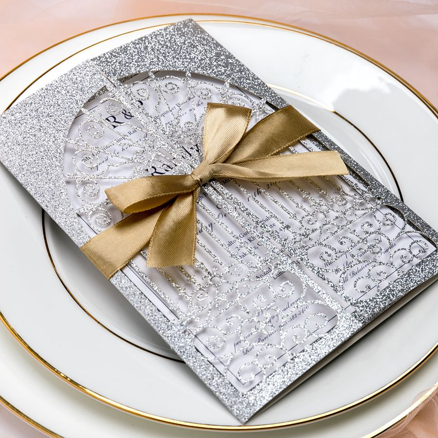 The glittering silver wrap with gate style adds luxury and formality to your wedding. The kit looks noble with gold shimmer ribbon