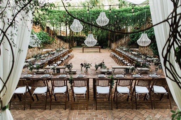 wedding head table with chandeliers