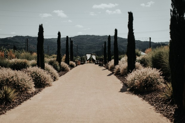 dramatic walk to the wedding ceremony space