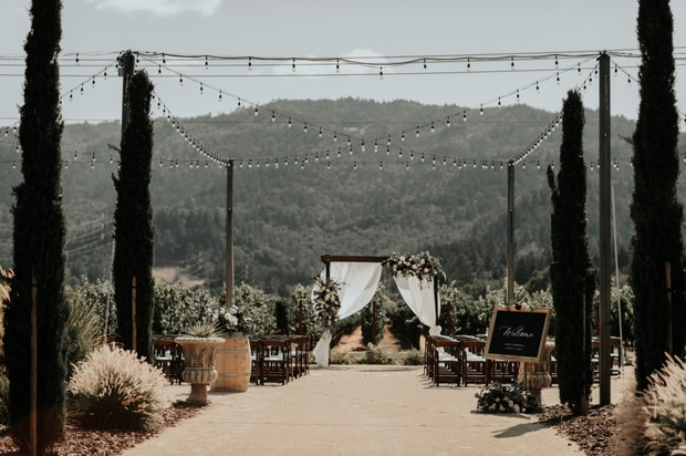 rustic chic tuscan style vineyard wedding ceremony