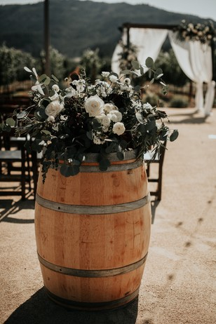 wine barrel floral decor for your wedding aisle