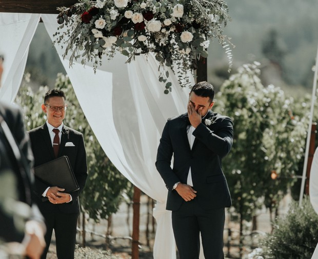 teary eyed groom seeing his bride for the first time