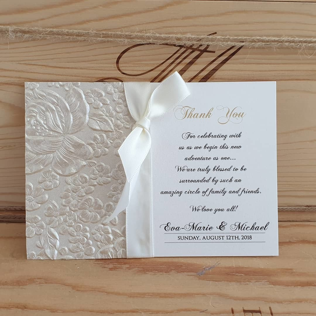 Coordinated wedding stationery samples for floral ivory
