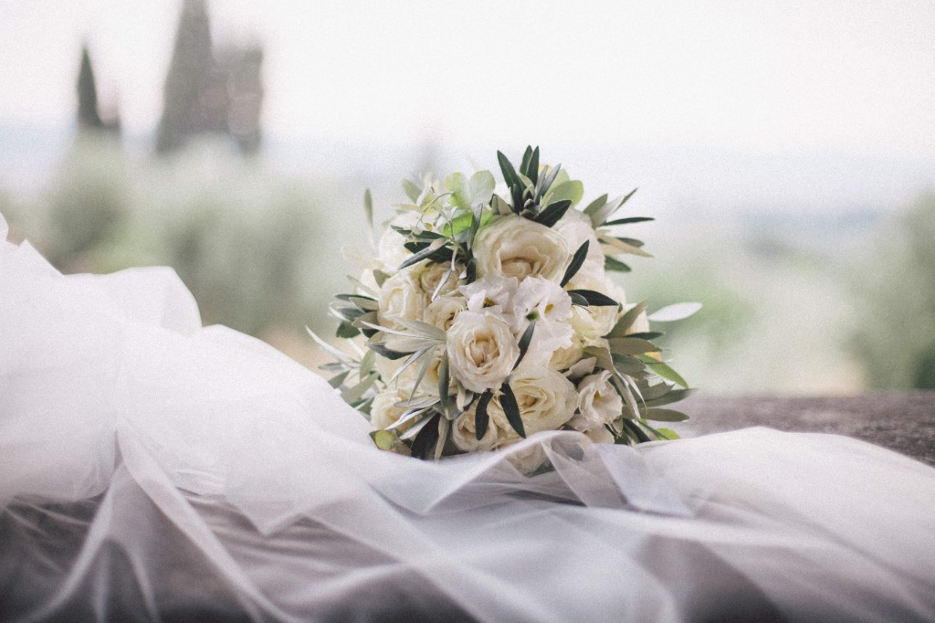 What a beautiful an classy bouquet. Olive leaves and white roses.