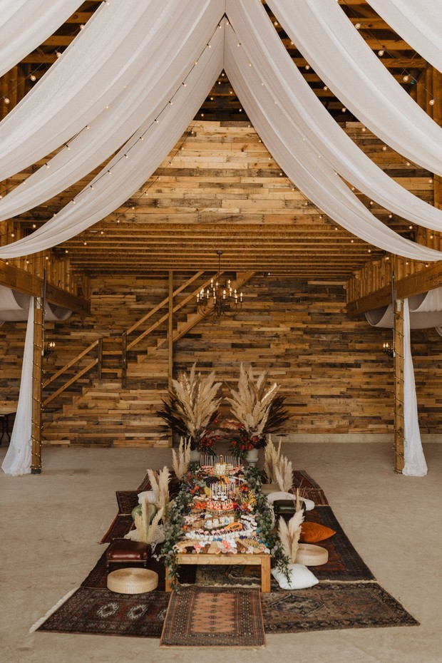 a boho pillow seating style wedding table