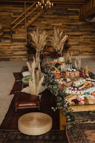 a rustic pillow seating dessert grazing table
