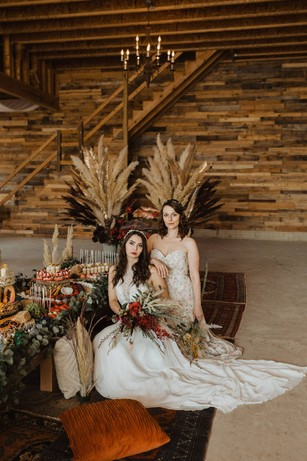 brides at their boho rustic themed table