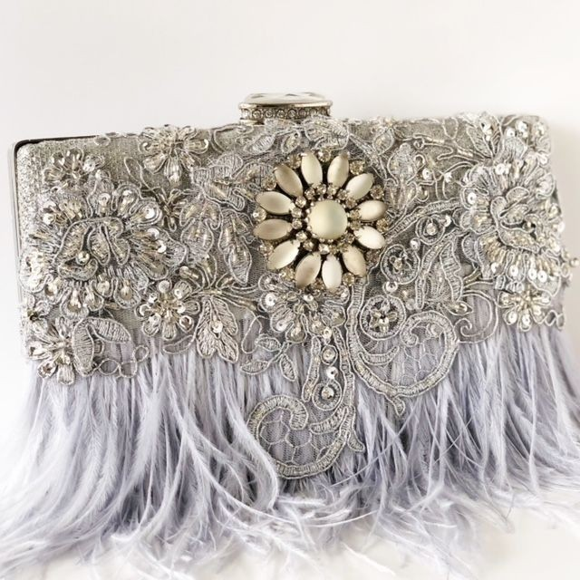 WOW them as you walk into your summer wedding with this gorgeous one of a kind ostrich gray feather clutch.