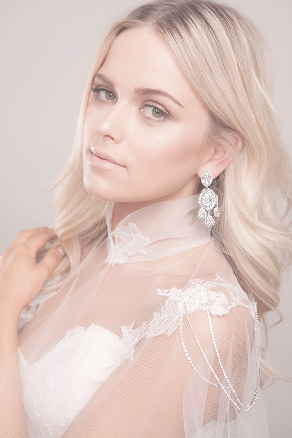 The beautiful and dramatic bridal jewelry is from Laura Jayne. Explore more amazing bridal jewelry and wedding inspiration from Laura
