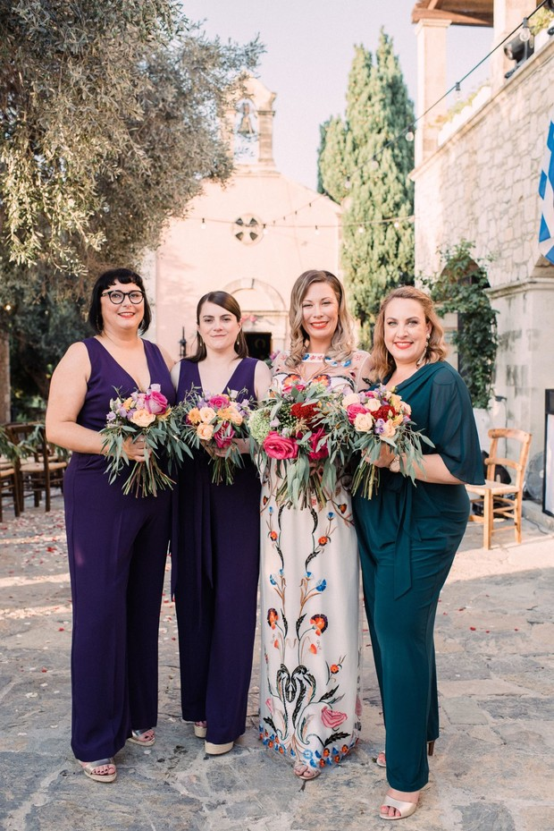 bride and her bridesmaids in jumpsuits