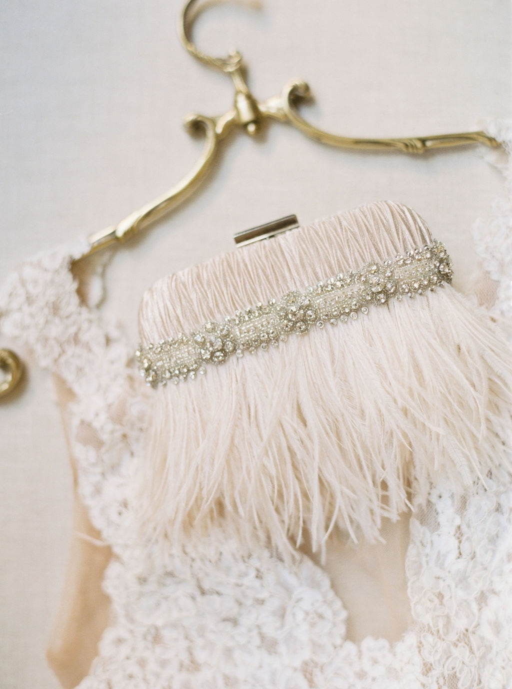Brand New!! This stunning blush ostrich feather and rhinestone bridal clutch.