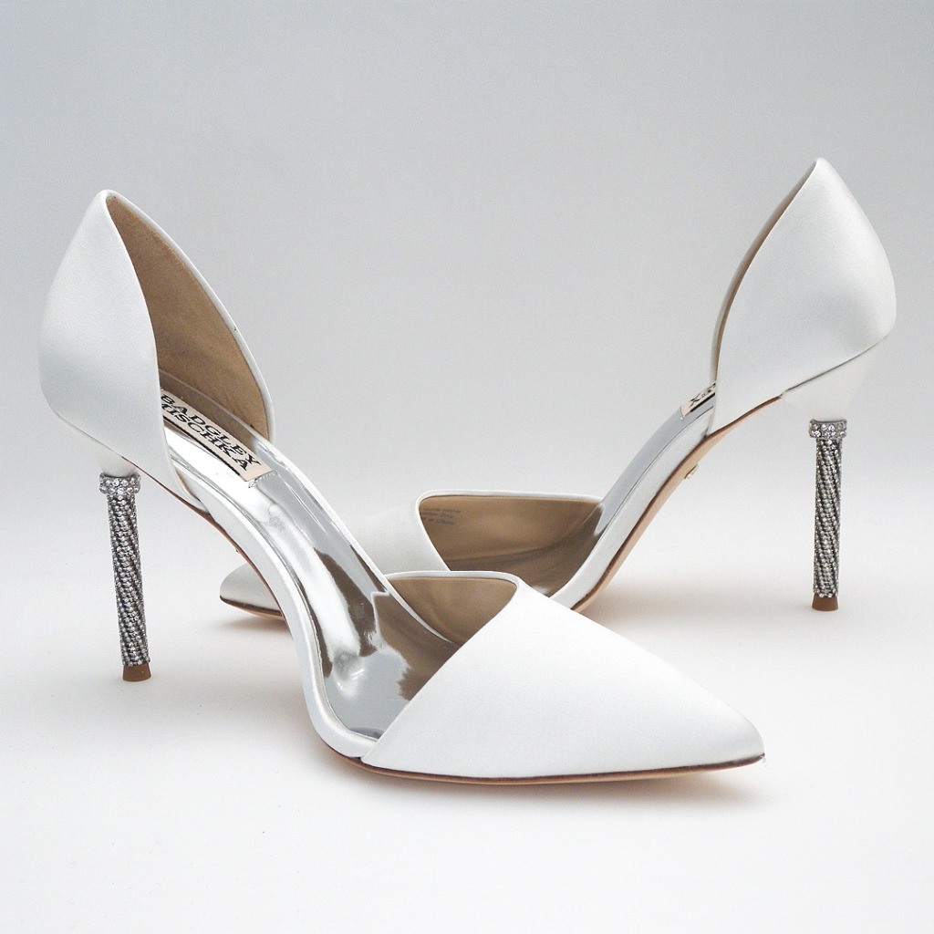 Classic silk white wedding shoes with a modern bride twist. D'Orsay Pump with a rhinestone adorned heel. Super sexy cut, modern &
