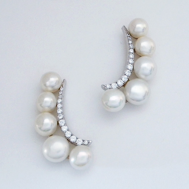 Glamorous and a bit trendy, pearl and CZ ear cuffs for weddings, eveningwear and of course cocktail parties! five graduated freshwater