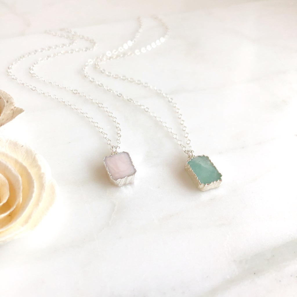 These stones are dyed cubic zirconia, about .5 long on 18 sterling silver chain.
