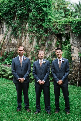 groom and groomsmen in slate grey suits