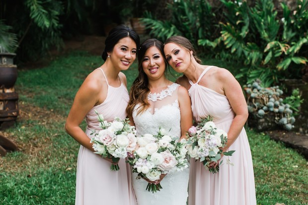 bride and her bridesmaids in soft pink