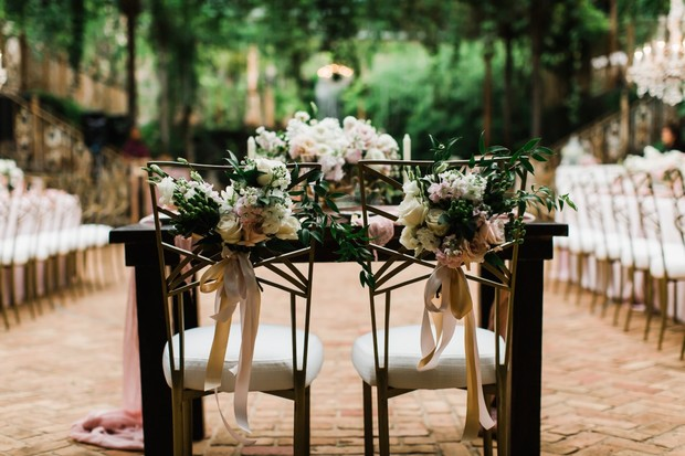 floral decorated sweetheart chairs