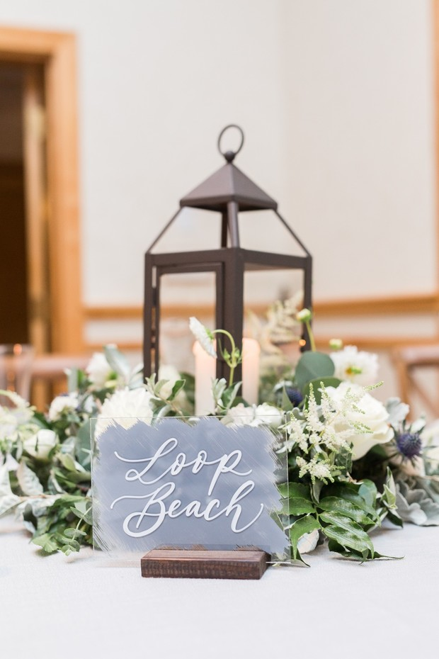 wedding table name with lantern centerpiece