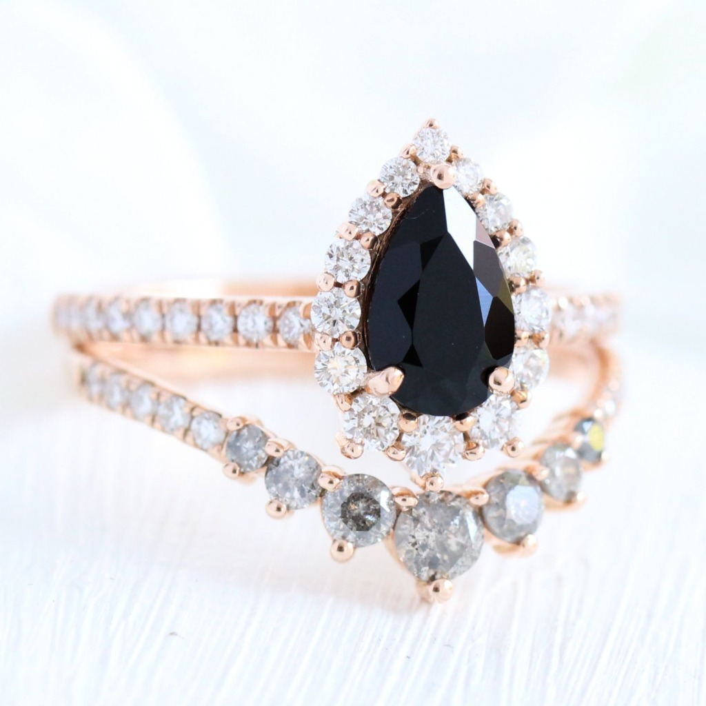 Non- traditional and Unique Bridal Set. This breathtakingly gorgeous black spinel diamond bridal set features a pear cut black spinel