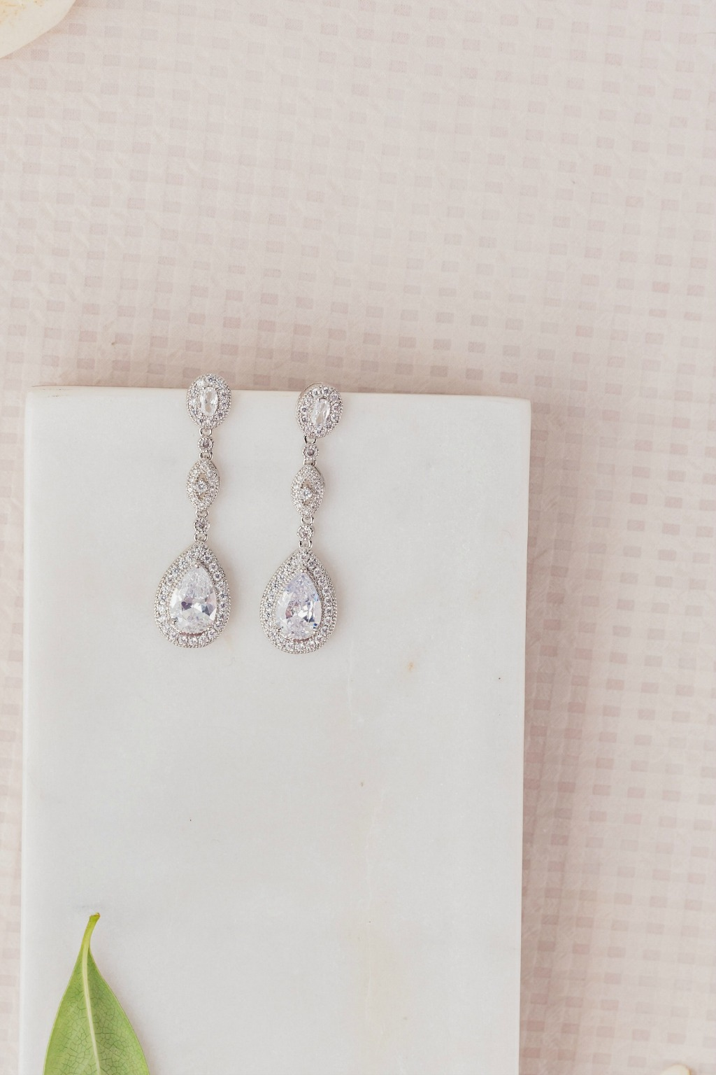 Add some glamour to your wedding look with the classic Maxima drop bridal earrings. Made with cubic zirconia crystals, these wedding