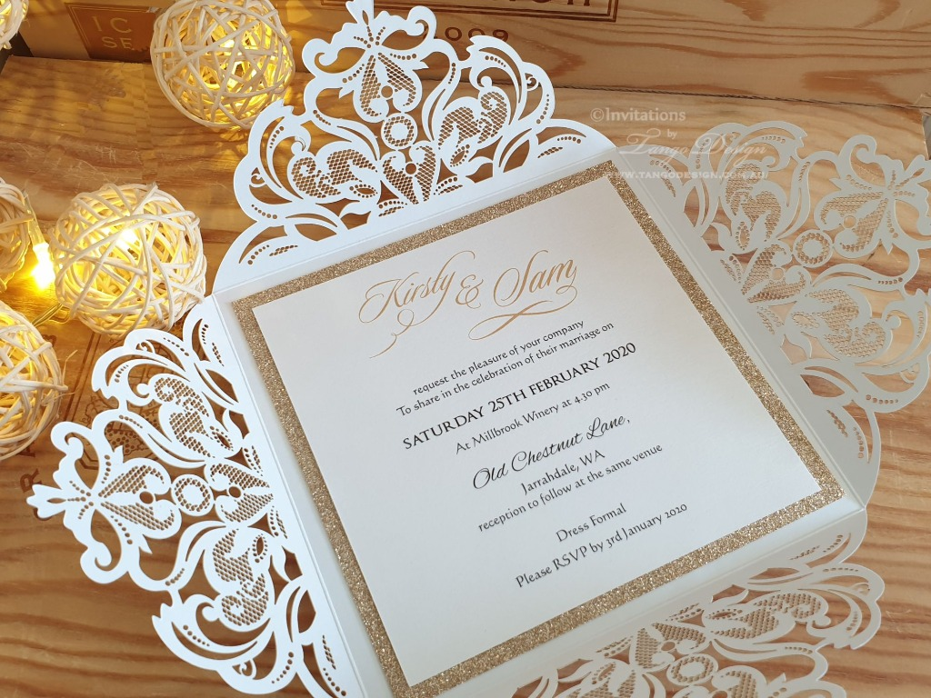 Stunning wedding invitations with gold glitter and lace design cut out