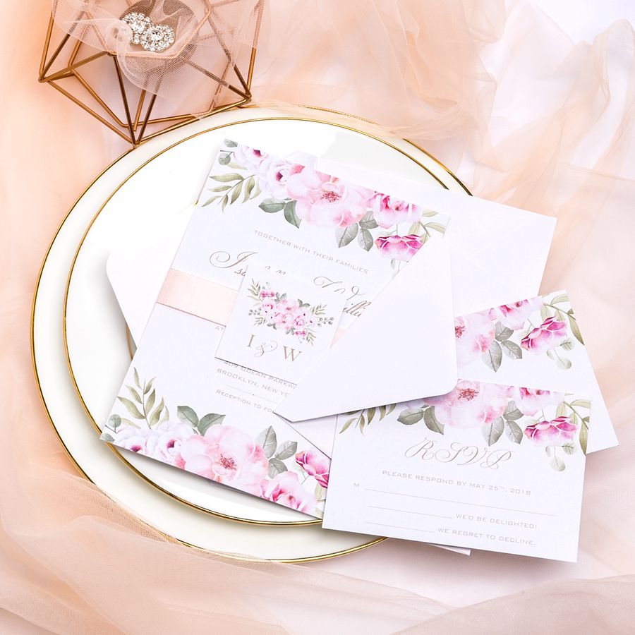 This elegant Bohemian style invitation features simple watercolor design and finished with a monogrammed tag and shimmer ribbon. If