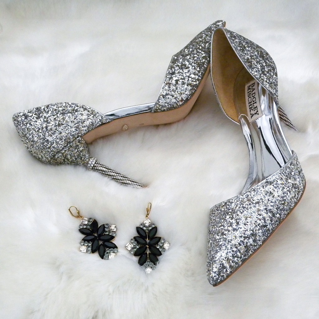 Glitter lover must have! Silver glitter covers an updated D'Orsay Pump with a rhinestone adorned heel.Super sexy cut, modern &