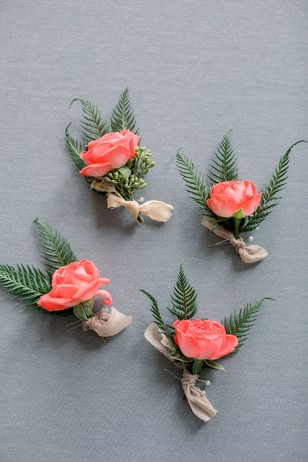 coral pink boutonnieres