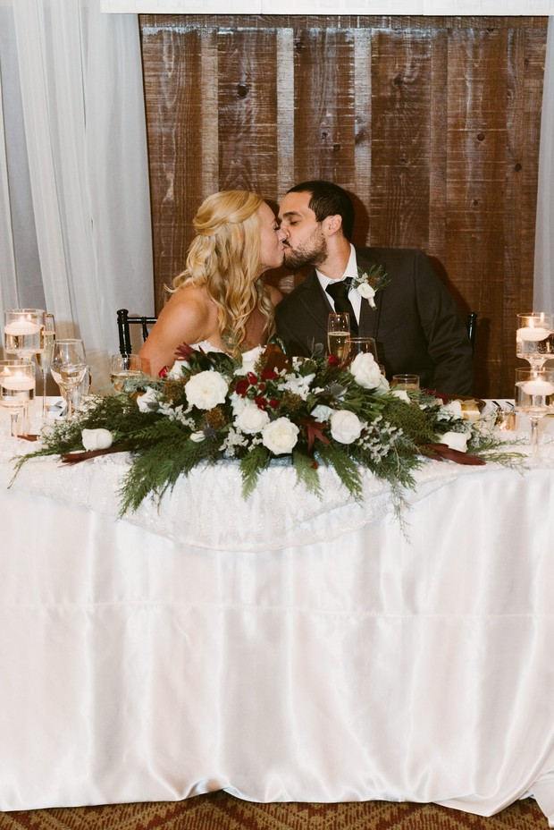 sweetheart table with kissing couple