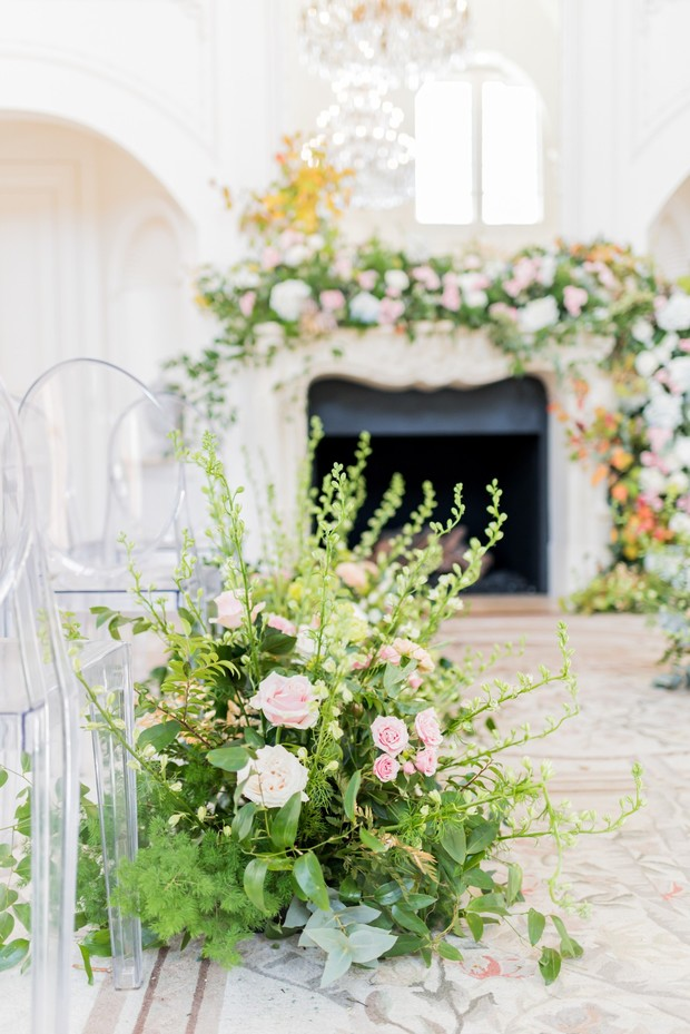 elegant overgrown garden inspired wedding aisle decor
