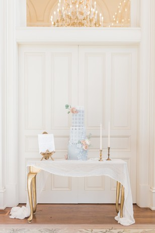 elegant gold and white wedding cake table idea