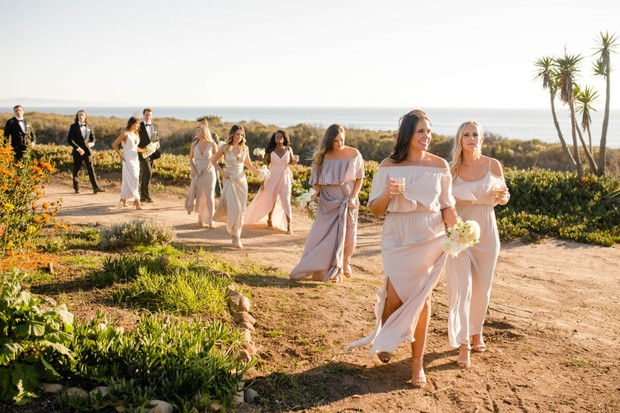 here comes the bridal party in muted pinks and champagne