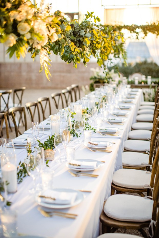white and gold wedding table decor with floating greenery decor