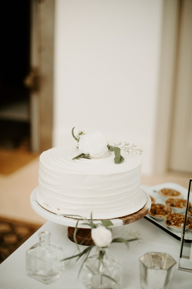 simple flower topped wedding cake