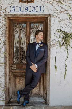 groom in bespoke suite and blue shoes