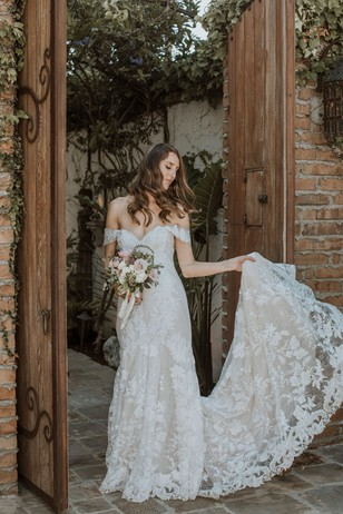the bride in her off the shoulder wedding dress