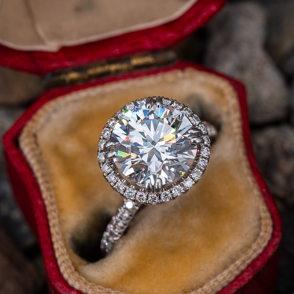 What do you think of the contrast of a modern halo ring nestled in an 100 year old antique case?
